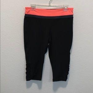 Black leggings with peach waistband